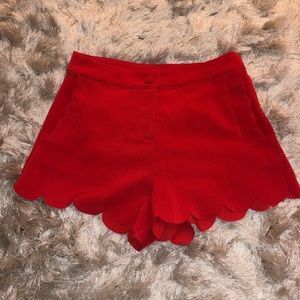 Red scalloped mid rise shorts